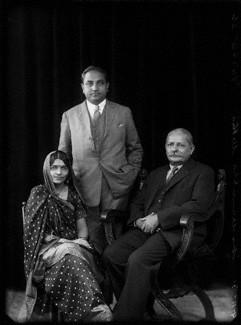 NPG x150710; Mrs Hansa Mehta; Dr Jivraj Narayan Mehta; Sir Manubhai Nandshankar Mehta by Bassano